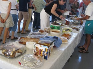Residents line up and fill their plates at the pot-luck.